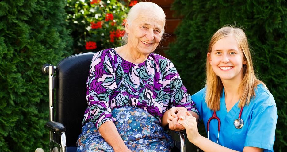 caregiver with elderly on wheelchair