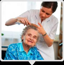 caregiver combing elderly's hair