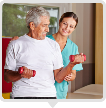 caregiver assisting elderly to be fit