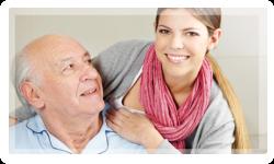 smiling caregiver with elderly