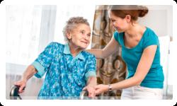 caregiver helping elderly on a wheelchair