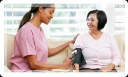 caregiver taking blood pressure