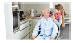 Happy caregiver with elderly on a wheelchair